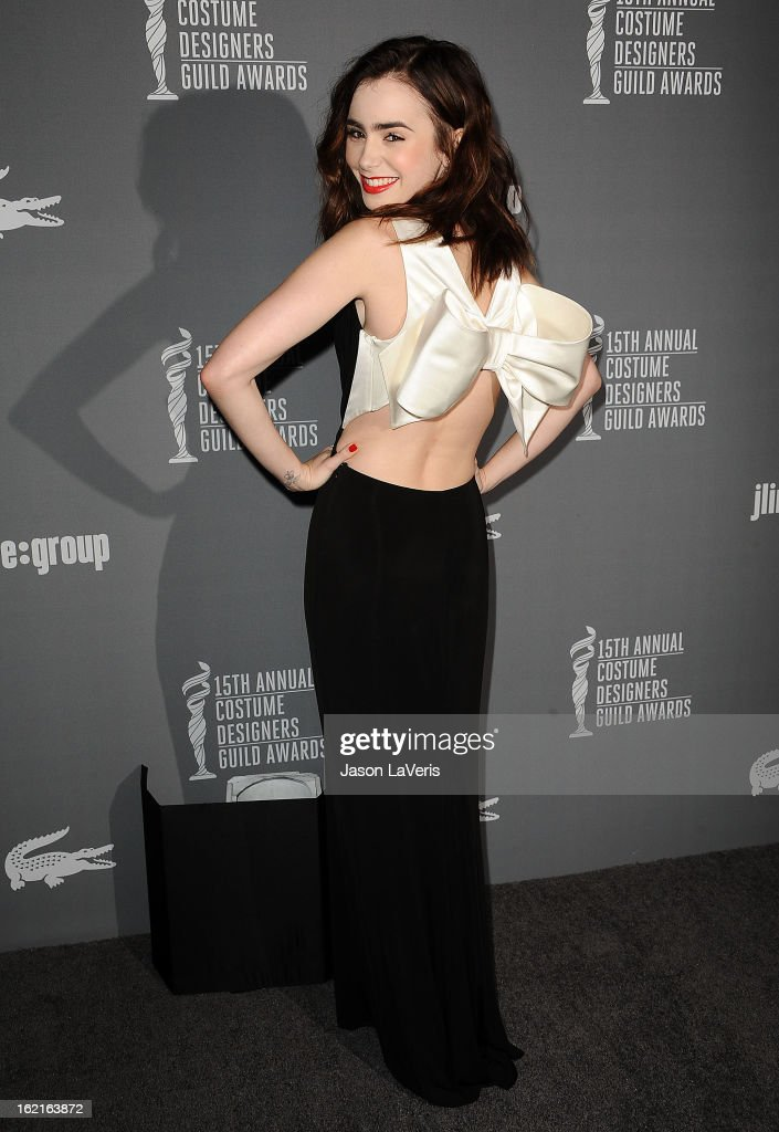 Actress Lily Collins attends the 15th annual Costume Designers Guild Awards at The Beverly Hilton Hotel on February 19, 2013 in Beverly Hills, California.