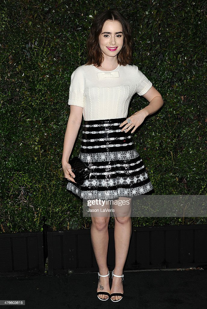 Actress Lily Collins attends the Chanel and Charles Finch pre-Oscar dinner at Madeo Restaurant on March 1, 2014 in Los Angeles, California.