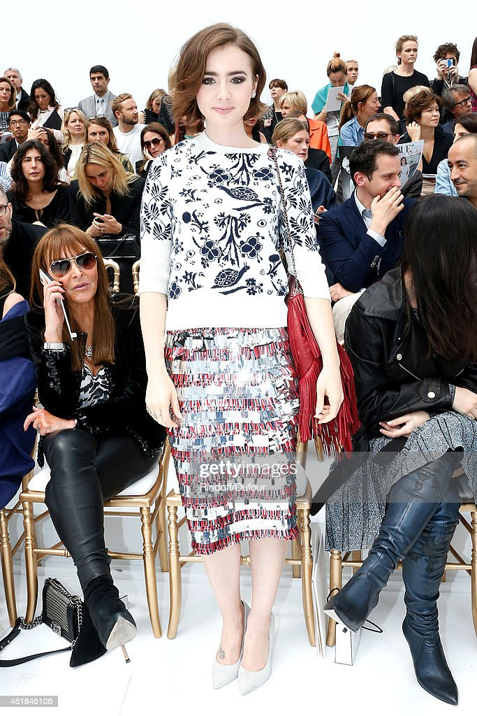 Actress <a gi-track='captionPersonalityLinkClicked' href=/galleries/search?phrase=Lily+Collins&family=editorial&specificpeople=3520243 ng-click='$event.stopPropagation()'>Lily Collins</a> attends the Chanel show as part of Paris Fashion Week - Haute Couture Fall/Winter 2014-2015. Held at Grand Palais on July 8, 2014 in Paris, France.