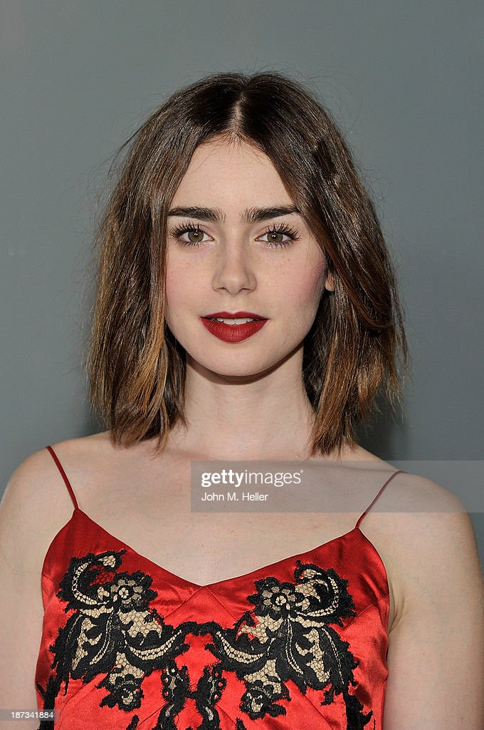 Actress Lily Collins attends the Flaunt Magazine En Garde! Issue launch party with Selena Gomez and Amanda De Cadenet at Hakkasan Restaurant Beverly Hills on November 7, 2013 in Beverly Hills, California.