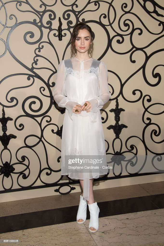 Actress Lily Collins attends the Givenchy show as part of the Paris Fashion Week Womenswear Spring/Summer 2018 at on October 1, 2017 in Paris, France.
