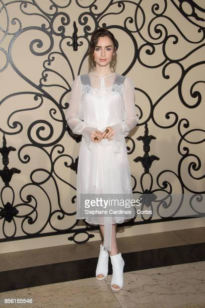 Actress Lily Collins attends the Givenchy show as part of the Paris Fashion Week Womenswear Spring/Summer 2018 at on October 1 2017 in Paris France