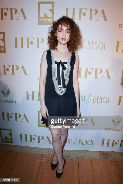 Actress Lily Collins attends the Hollywood Foreign Press Association's 2017 Cannes Film Festival Event in honour of the International Rescue...