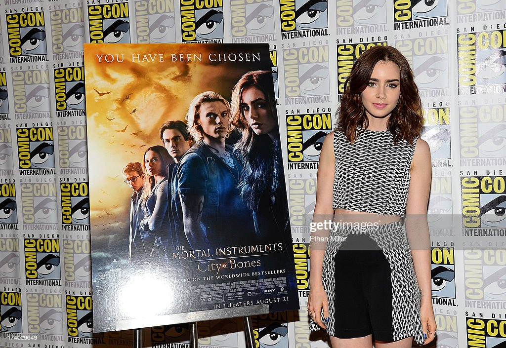 Actress Lily Collins attends 'The Mortal Instruments: City of Bones' press line during Comic-Con International 2013 at the Hilton San Diego Bayfront Hotel on July 19, 2013 in San Diego, California.