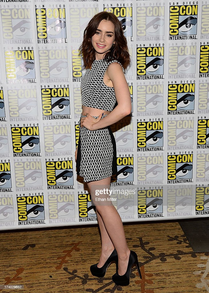 Actress <a gi-track='captionPersonalityLinkClicked' href=/galleries/search?phrase=Lily+Collins&family=editorial&specificpeople=3520243 ng-click='$event.stopPropagation()'>Lily Collins</a> attends 'The Mortal Instruments: City of Bones' press line during Comic-Con International 2013 at the Hilton San Diego Bayfront Hotel on July 19, 2013 in San Diego, California.