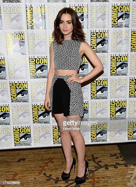 Actress Lily Collins attends 'The Mortal Instruments City of Bones' press line during ComicCon International 2013 at the Hilton San Diego Bayfront...