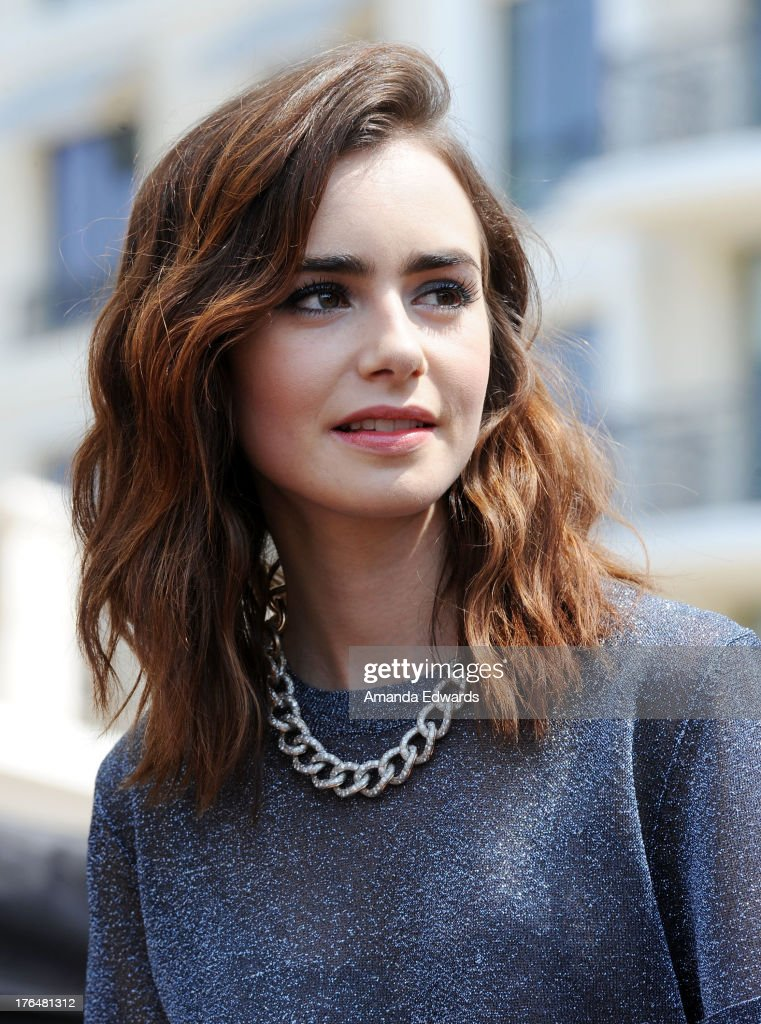 Actress <a gi-track='captionPersonalityLinkClicked' href=/galleries/search?phrase=Lily+Collins&family=editorial&specificpeople=3520243 ng-click='$event.stopPropagation()'>Lily Collins</a> attends 'The Mortal Instruments: City Of Bones' meet and greet at The Americana at Brand on August 13, 2013 in Glendale, California.
