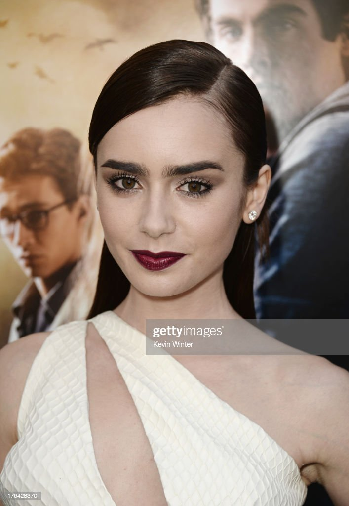 Actress <a gi-track='captionPersonalityLinkClicked' href=/galleries/search?phrase=Lily+Collins&family=editorial&specificpeople=3520243 ng-click='$event.stopPropagation()'>Lily Collins</a> attends the premiere of Screen Gems & Constantin Films' 'The Mortal Instruments: City of Bones' at ArcLight Cinemas Cinerama Dome on August 12, 2013 in Hollywood, California.