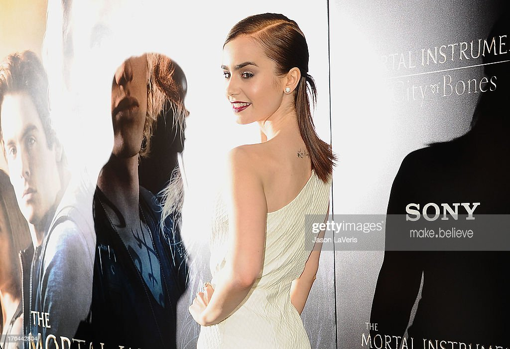 Actress <a gi-track='captionPersonalityLinkClicked' href=/galleries/search?phrase=Lily+Collins&family=editorial&specificpeople=3520243 ng-click='$event.stopPropagation()'>Lily Collins</a> attends the premiere of 'The Mortal Instruments: City Of Bones' at ArcLight Cinemas Cinerama Dome on August 12, 2013 in Hollywood, California.