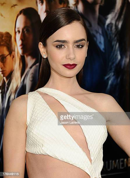 Actress Lily Collins attends the premiere of 'The Mortal Instruments City Of Bones' at ArcLight Cinemas Cinerama Dome on August 12 2013 in Hollywood...