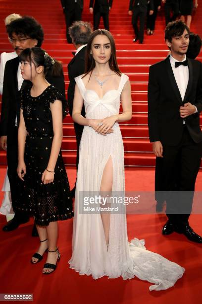 Actress Lily Collins departs the 'Okja' premiere during the 70th annual Cannes Film Festival at Palais des Festivals on May 19 2017 in Cannes France
