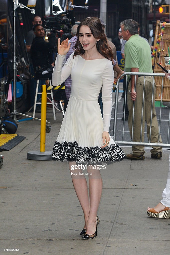 Actress Lily Collins enters the 'Good Morning America' taping at the ABC Times Square Studios on August 7, 2013 in New York City.