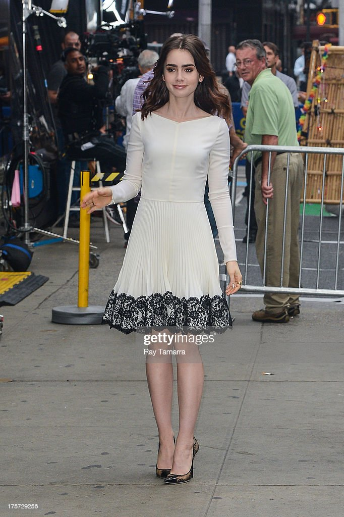 Actress <a gi-track='captionPersonalityLinkClicked' href=/galleries/search?phrase=Lily+Collins&family=editorial&specificpeople=3520243 ng-click='$event.stopPropagation()'>Lily Collins</a> enters the 'Good Morning America' taping at the ABC Times Square Studios on August 7, 2013 in New York City.