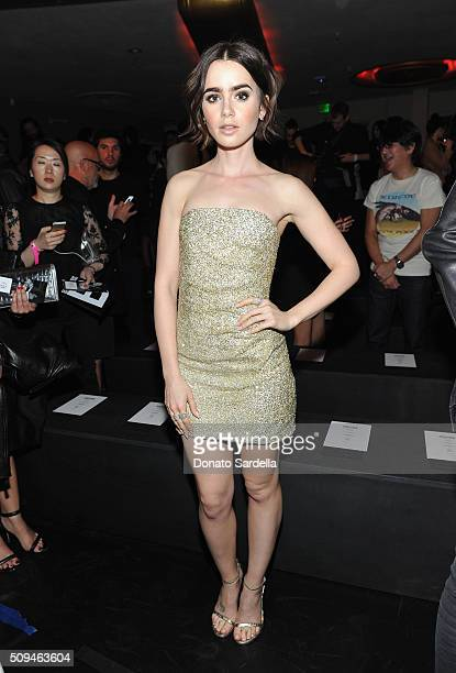 Actress Lily Collins in Saint Laurent by Hedi Slimane attends Saint Laurent at the Palladium on February 10 2016 in Los Angeles California for the...