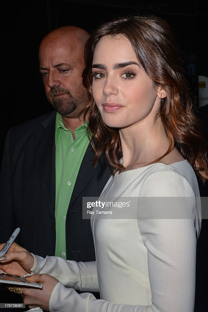 Actress <a gi-track='captionPersonalityLinkClicked' href=/galleries/search?phrase=Lily+Collins&family=editorial&specificpeople=3520243 ng-click='$event.stopPropagation()'>Lily Collins</a> leaves the 'Good Morning America' taping at the ABC Times Square Studios on August 7, 2013 in New York City.