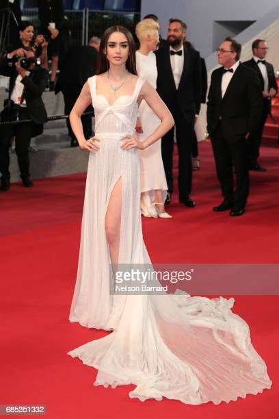 Actress Lily Collins leaves the 'Okja' screening during the 70th annual Cannes Film Festival at Palais des Festivals on May 19 2017 in Cannes France