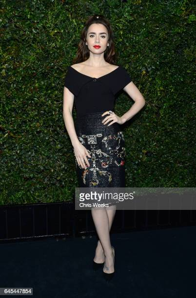 Actress Lily Collins wearing CHANEL attends the Charles Finch and CHANEL PreOscar Awards Dinner at Madeo Restaurant on February 25 2017 in Beverly...