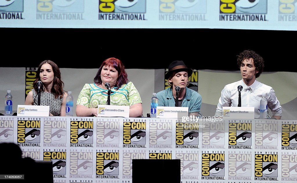 Actress Lily Collins, writer Cassandra Clare, actors Jamie Campbell Bower, and Robert Sheehan speak onstage at the Sony and Screen Gems panel for 'The Mortal Instruments: City of Bones' during Comic-Con International 2013 at San Diego Convention Center on July 19, 2013 in San Diego, California.