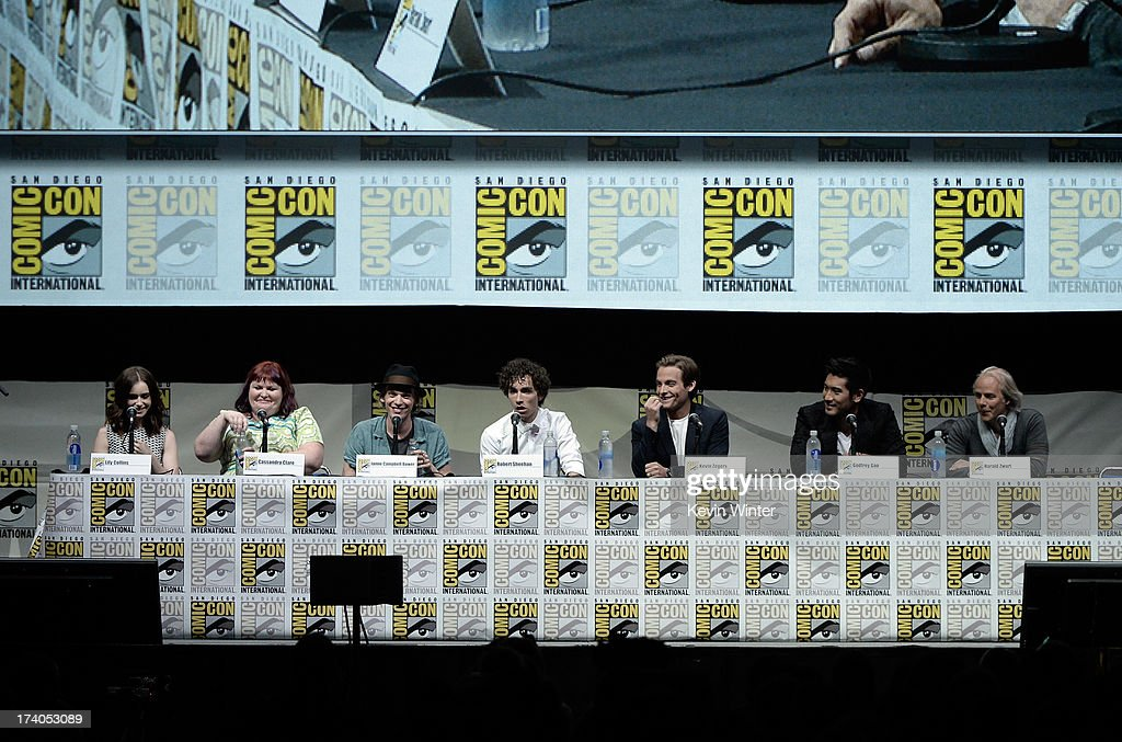 Actress Lily Collins, writer Cassandra Clare, actors Jamie Campbell Bower, Robert Sheehan, Kevin Zegers, Godfrey Gao, and director Harald Zwart speak onstage at the Sony and Screen Gems panel for 'The Mortal Instruments: City of Bones' during Comic-Con International 2013 at San Diego Convention Center on July 19, 2013 in San Diego, California.