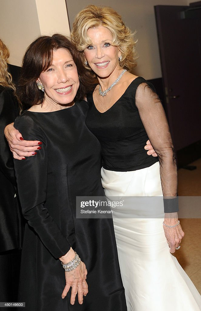 Actress <a gi-track='captionPersonalityLinkClicked' href=/galleries/search?phrase=Lily+Tomlin&family=editorial&specificpeople=208236 ng-click='$event.stopPropagation()'>Lily Tomlin</a> (L) and honoree <a gi-track='captionPersonalityLinkClicked' href=/galleries/search?phrase=Jane+Fonda&family=editorial&specificpeople=202174 ng-click='$event.stopPropagation()'>Jane Fonda</a> backstage during the 2014 AFI Life Achievement Award: A Tribute to <a gi-track='captionPersonalityLinkClicked' href=/galleries/search?phrase=Jane+Fonda&family=editorial&specificpeople=202174 ng-click='$event.stopPropagation()'>Jane Fonda</a> at the Dolby Theatre on June 5, 2014 in Hollywood, California. Tribute show airing Saturday, June 14, 2014 at 9pm ET/PT on TNT.