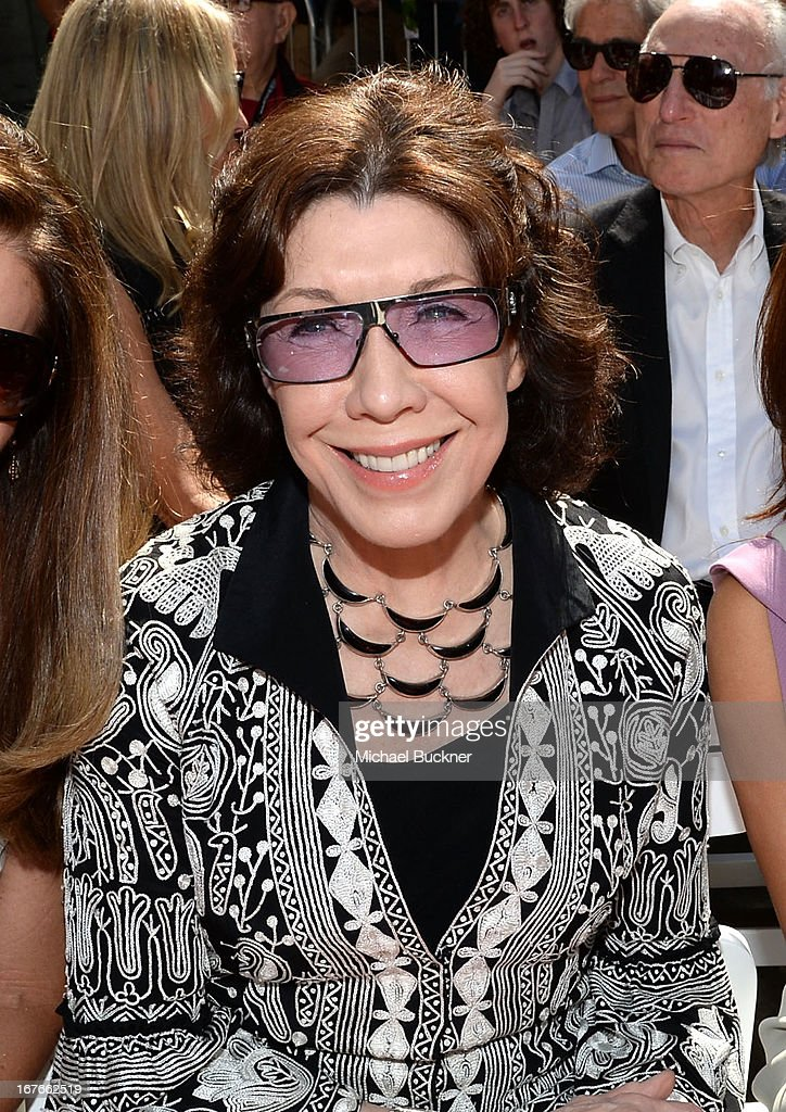 Actress <a gi-track='captionPersonalityLinkClicked' href=/galleries/search?phrase=Lily+Tomlin&family=editorial&specificpeople=208236 ng-click='$event.stopPropagation()'>Lily Tomlin</a> attends actress Jane Fonda's Handprint/Footprint Ceremony during the 2013 TCM Classic Film Festival at TCL Chinese Theatre on April 27, 2013 in Los Angeles, California. 23632_009_MB_0525.JPG