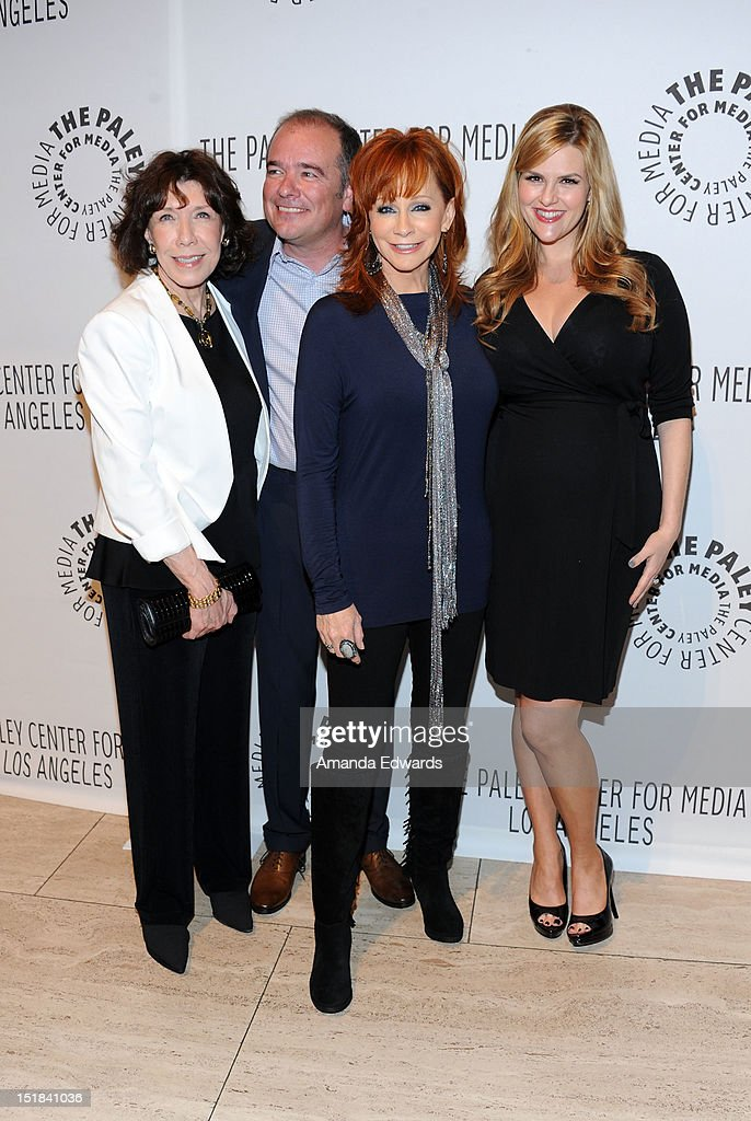Actress <a gi-track='captionPersonalityLinkClicked' href=/galleries/search?phrase=Lily+Tomlin&family=editorial&specificpeople=208236 ng-click='$event.stopPropagation()'>Lily Tomlin</a>, Executive Producer Kevin Abbott and actresses <a gi-track='captionPersonalityLinkClicked' href=/galleries/search?phrase=Reba+McEntire&family=editorial&specificpeople=202959 ng-click='$event.stopPropagation()'>Reba McEntire</a> and <a gi-track='captionPersonalityLinkClicked' href=/galleries/search?phrase=Sara+Rue&family=editorial&specificpeople=203287 ng-click='$event.stopPropagation()'>Sara Rue</a> arrive at the 2012 PayleyFest : Fall TV Preview Party -ABC at The Paley Center for Media on September 11, 2012 in Beverly Hills, California.