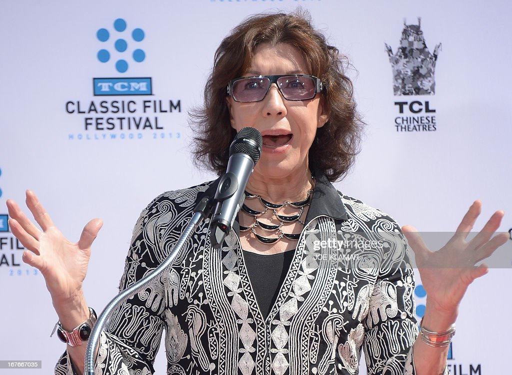 Actress Lily Tomlin speaks during Jane Fonda's Handprint/Footprint Ceremony during the 2013 TCM Classic Film Festival at TCL Chinese Theatre on April 27, 2013 in Los Angeles. Fonda is an American actress, writer, political activist, former fashion model, and fitness guru. She rose to fame in the 1960s with films such as Barbarella and Cat Ballou. She has won two Academy Awards, an Emmy Award, three Golden Globes and received several other movie awards and nominations during more than 50 years as an actress. After 15 years of retirement, she returned to film in 2005 with Monster-in-Law, followed by Georgia Rule two years later. She also produced and starred in over 20 exercise videos released between 1982 and 1995, and once again in 2010.