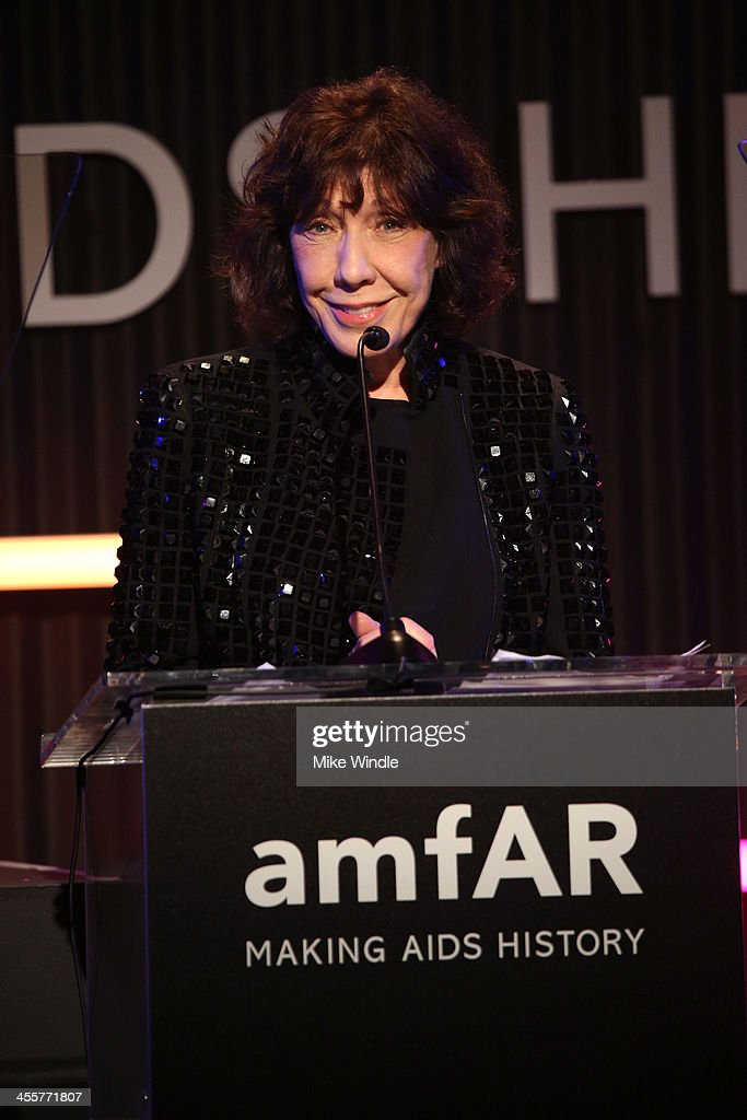 Actress <a gi-track='captionPersonalityLinkClicked' href=/galleries/search?phrase=Lily+Tomlin&family=editorial&specificpeople=208236 ng-click='$event.stopPropagation()'>Lily Tomlin</a> speaks onstage during the 2013 amfAR Inspiration Gala Los Angeles presented by MAC Viva Glam at Milk Studios on December 12, 2013 in Los Angeles, California.