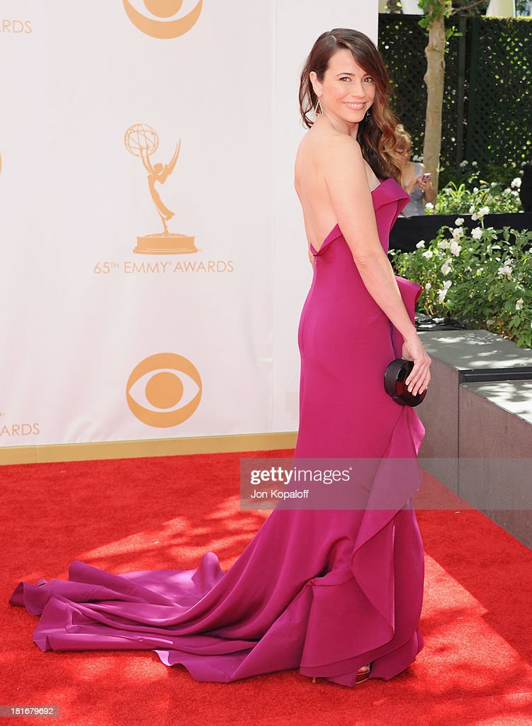 Actress <a gi-track='captionPersonalityLinkClicked' href=/galleries/search?phrase=Linda+Cardellini&family=editorial&specificpeople=215483 ng-click='$event.stopPropagation()'>Linda Cardellini</a> arrives at the 65th Annual Primetime Emmy Awards at Nokia Theatre L.A. Live on September 22, 2013 in Los Angeles, California.