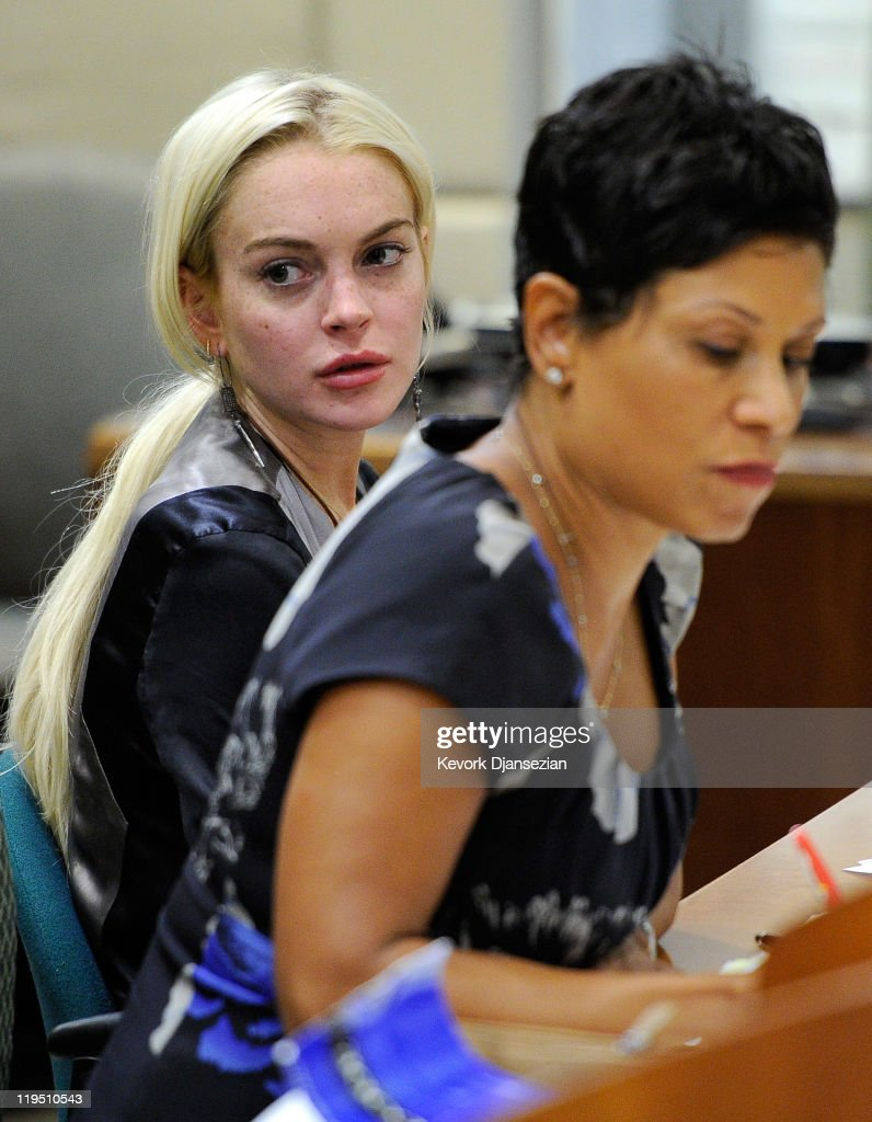 Actress Lindsay Lohan and her attorney Shawn Chapman Holley appear at the Airport Branch Courthouse for her progress report hearing on July 21 2011...