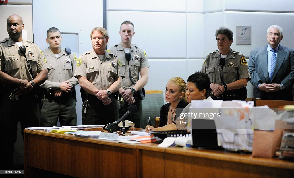 Actress Lindsay Lohan and her attorney Shawn Chapman Holley attend a preliminary hearing at Airport Courthouse on February 23 2011 in Los Angeles...