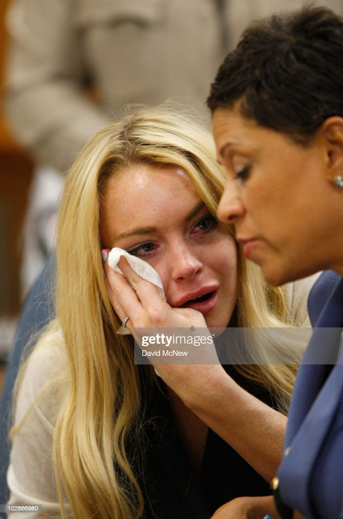 Actress Lindsay Lohan and lawyer Shawn Chapman Holley attend a probation revocation hearing at the Beverly Hills Courthouse on July 6 2010 in Los...