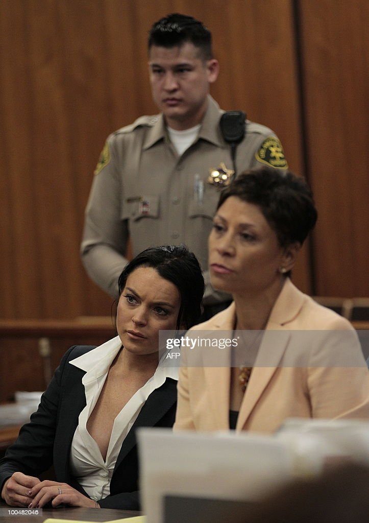 US actress Lindsay Lohan (L) and lawyer Shawn Chapman Holley (R) listen during a hearing to respond to allegations she has not completed a set number of alcohol education classes, at the Beverly Hills Courthouse on May 24, 2010. Lohan who failed to appear for a court hearing in Los Angeles last week, prompted a judge to issue an arrest warrant that was later withdrawn when lawyers for the troubled actress posted bail. Lohan, 23, had been ordered to appear before Judge Marsha Revel to respond to allegations she has not completed a set number of alcohol education classes required under the terms of her probation. AFP PHOTO/POOL/Jae C. Hong