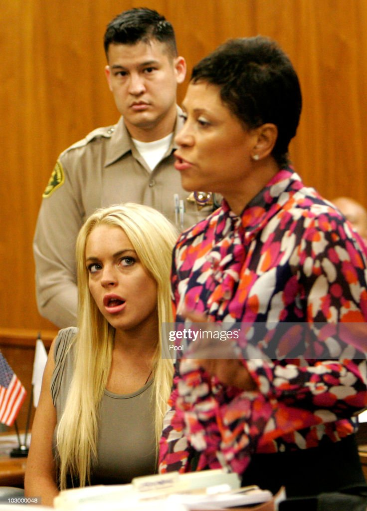 Actress Lindsay Lohan and lawyer Shawn Chapman Holley speak in court during Lindsay Lohan surrender at the Beverly Hills Courthouse to serve her 90...