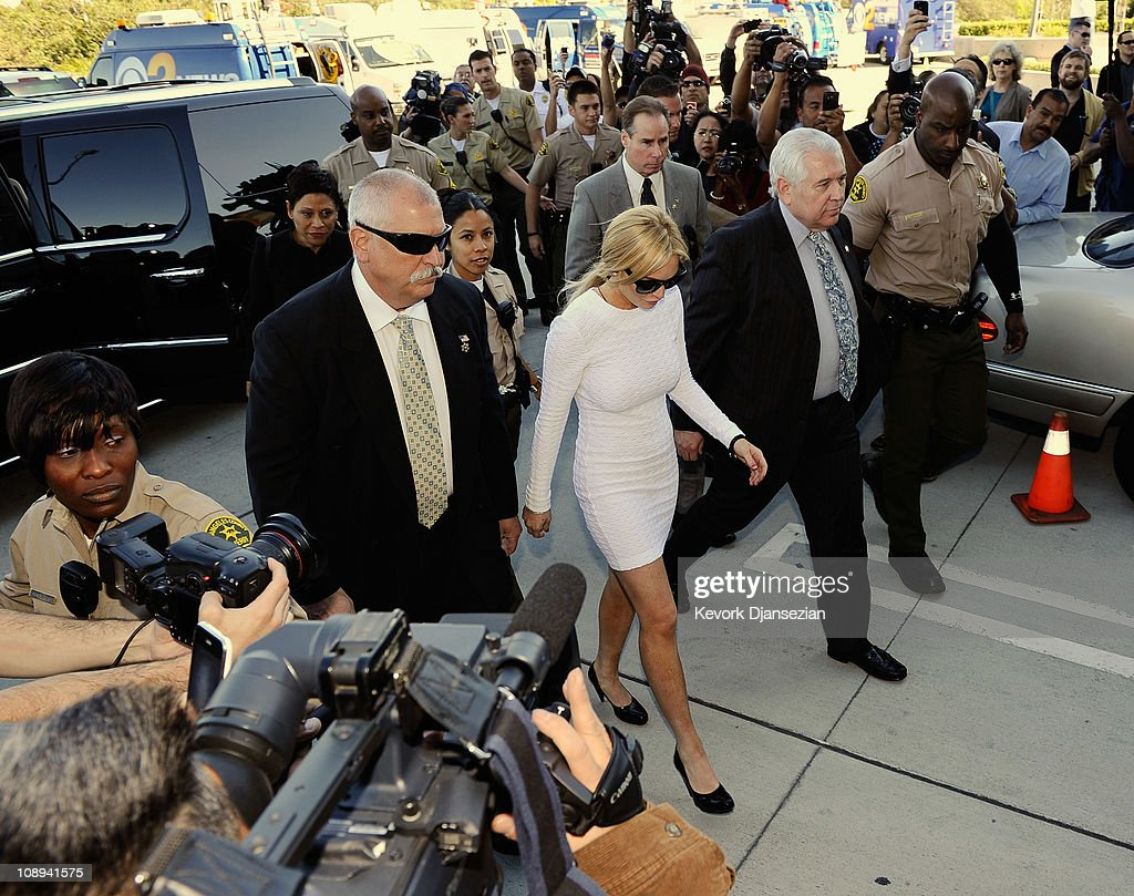 Actress Lindsay Lohan and Lohan's lawyer Shawn Chapman Holley arrive for her arraignment for a felony count of grand theft on February 9 2011 in Los...