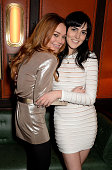 Actress Lindsay Lohan and sister Ali Lohan attend the LOVE x Balmain Xmas Party at The Ivy Market Grill on December 15 2014 in London England