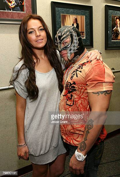 Actress Lindsay Lohan and WWE Superstar Rey Mysterio at WWE Monday Night Raw at The Honda Center on February 18 2008 in Anaheim California