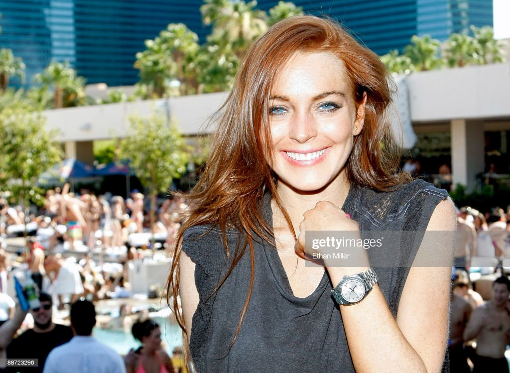 Actress <a gi-track='captionPersonalityLinkClicked' href=/galleries/search?phrase=Lindsay+Lohan&family=editorial&specificpeople=171623 ng-click='$event.stopPropagation()'>Lindsay Lohan</a> appears at the Wet Republic pool at the MGM Grand Hotel/Casino as she celebrates her birthday and her Sevin Nyne brand tanning mist June 27, 2009 in Las Vegas, Nevada. Lohan turns 23 on July 2.