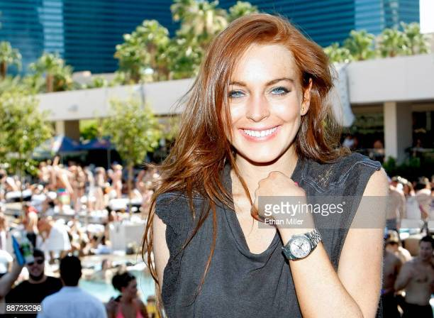 Actress Lindsay Lohan appears at the Wet Republic pool at the MGM Grand Hotel/Casino as she celebrates her birthday and her Sevin Nyne brand tanning...