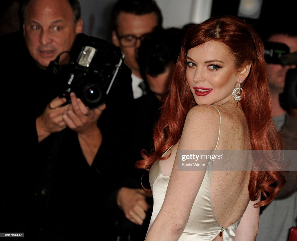 Actress Lindsay Lohan arrives at a party to celebrate Lifetime's 'Liz & Dick' at the Beverly Hills Hotel on November 20, 2012 in Beverly Hills, California.