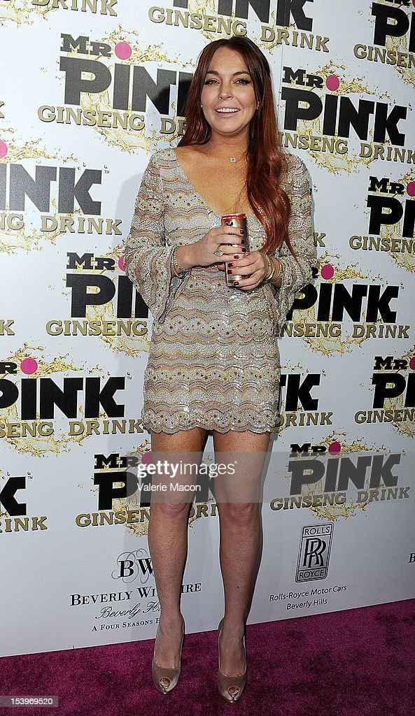 Actress <a gi-track='captionPersonalityLinkClicked' href=/galleries/search?phrase=Lindsay+Lohan&family=editorial&specificpeople=171623 ng-click='$event.stopPropagation()'>Lindsay Lohan</a> arrives at Mr. Pink Ginseng Drink Launch Party on October 11, 2012 in Beverly Hills, California.