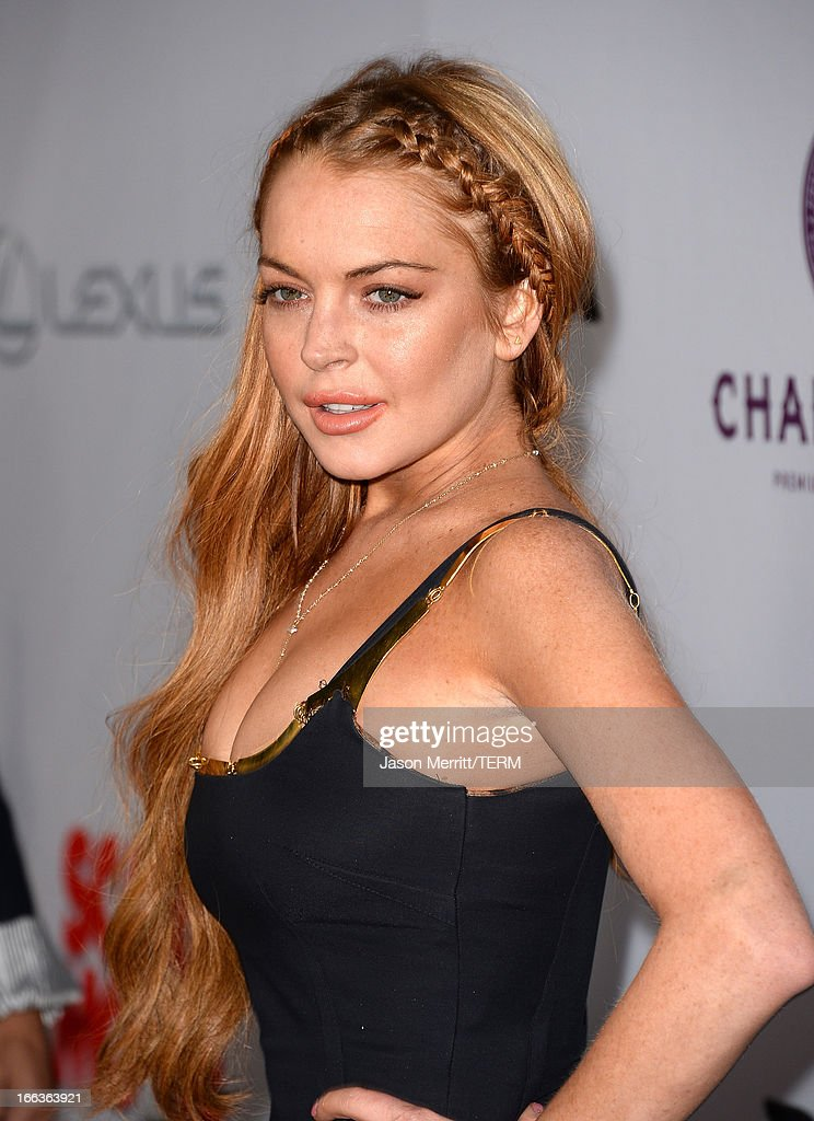Actress Lindsay Lohan arrives at the Dimension Films' 'Scary Movie 5' premiere at the ArcLight Cinemas Cinerama Dome on April 11, 2013 in Hollywood, California.