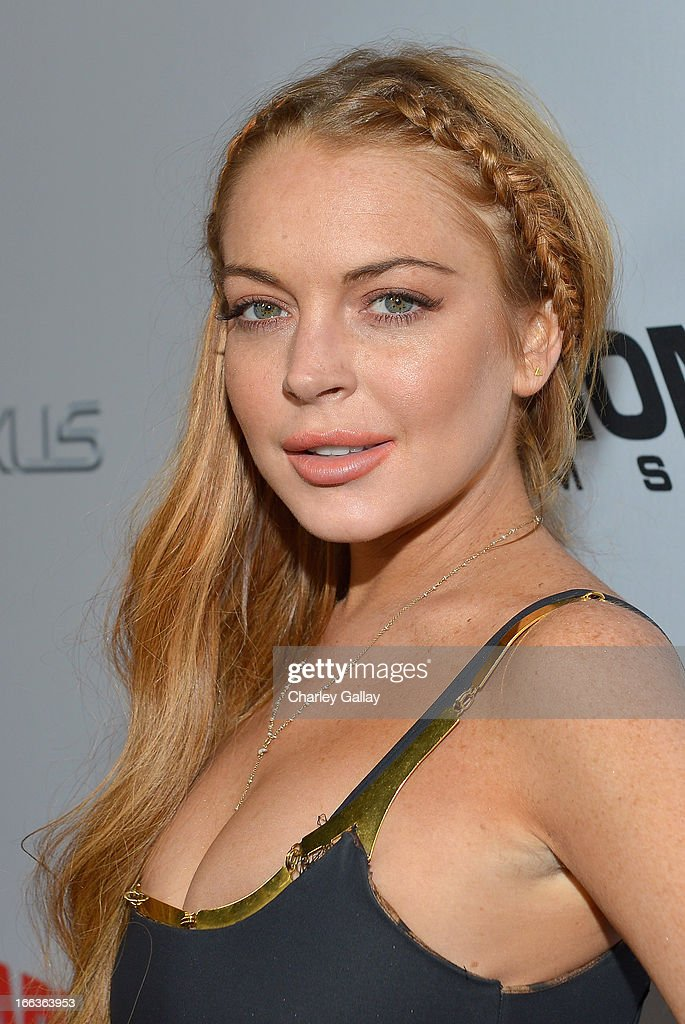 Actress Lindsay Lohan arrives at the premiere of 'Scary Movie V' presented by Dimension Films, in partnership with Lexus and Chambord at the Cinerama Dome on April 11, 2013 in Los Angeles, California.
