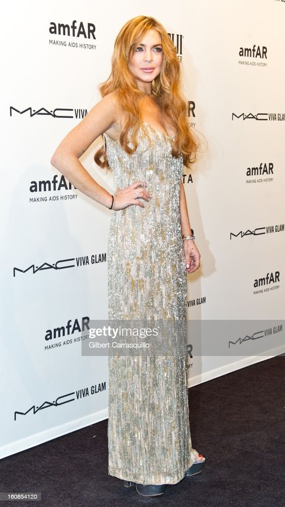 Actress Lindsay Lohan attends amfAR New York Gala To Kick Off Fall 2013 Fashion Week Cipriani Wall Street on February 6, 2013 in New York City.