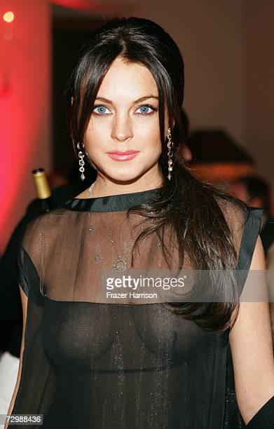 Actress Lindsay Lohan attends an intimate dinner hosted by Chanel and Sienna Miller in honor of Les Exclusifs de Chanel held at Chateau Marmont on...