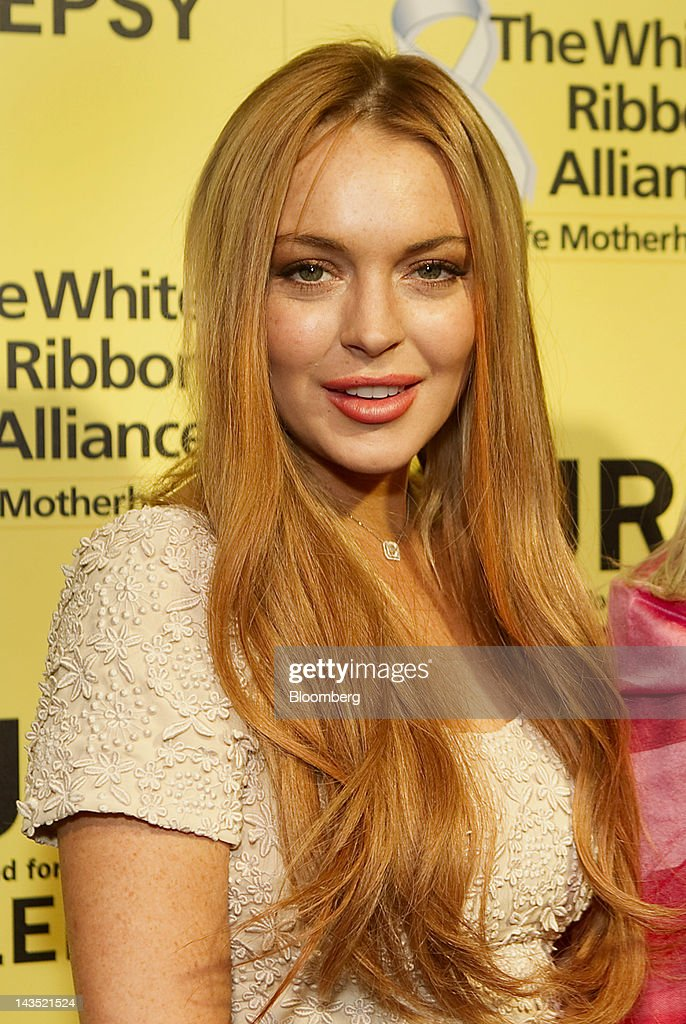 Actress Lindsay Lohan attends the 19th Annual White House Correspondents' Garden Brunch in Washington, D.C., U.S., on Saturday, April 28, 2012. This year's event will raise money for the Citizens United for Research in Epilepsy (CURE) and The White Ribbon Alliance for Safe Motherhood organizations. Photographer: Andrew Harrer/Bloomberg via Getty Images