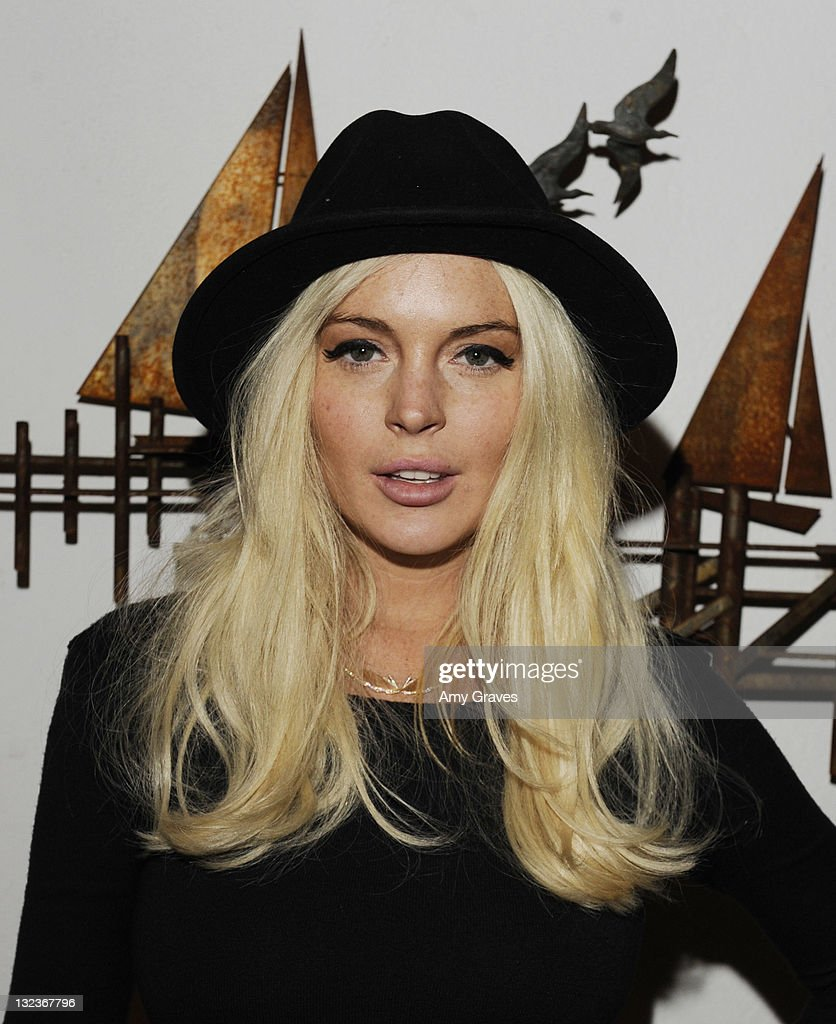 Actress <a gi-track='captionPersonalityLinkClicked' href=/galleries/search?phrase=Lindsay+Lohan&family=editorial&specificpeople=171623 ng-click='$event.stopPropagation()'>Lindsay Lohan</a> attends the Lana Gomez Art Show at Roseark on November 11, 2011 in Los Angeles, California.