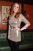 Actress Lindsay Lohan attends the LOVE x Balmain Xmas Party at The Ivy Market Grill on December 15 2014 in London England