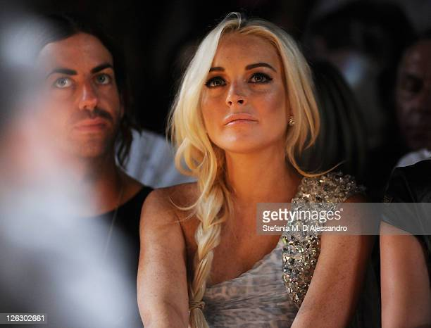 Actress Lindsay Lohan attends the Philipp Plein Urban Jungle Spring/Summer 2012 fashion show as part Milan Womenswear Fashion Week on September 24...