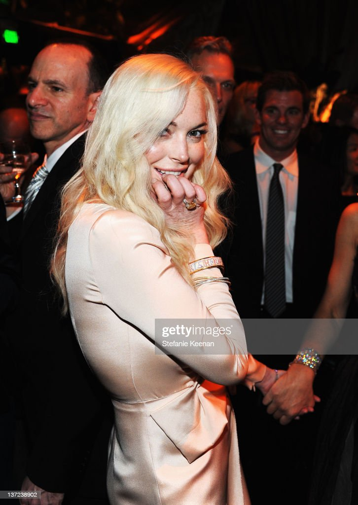Actress <a gi-track='captionPersonalityLinkClicked' href=/galleries/search?phrase=Lindsay+Lohan&family=editorial&specificpeople=171623 ng-click='$event.stopPropagation()'>Lindsay Lohan</a> attends The Weinstein Company Celebration of the 2012 Golden Globes presented by Chopard held at The Beverly Hilton hotel on January 15, 2012 in Beverly Hills, California.